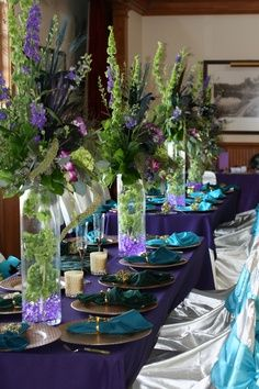 wine bottle arrangements         .jewel-toned tablescape