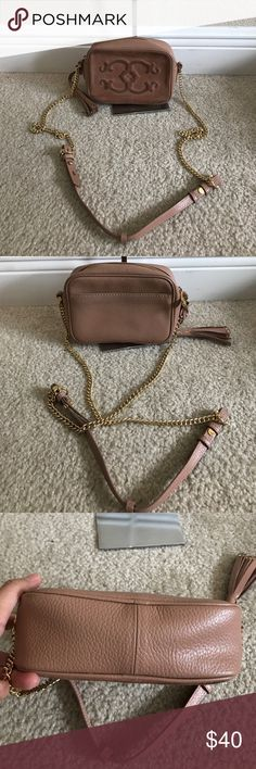 """C. Wonder Pebble Leather &Suede Crossbody Handbag Preown good condition. Some worn signs front and back. Color faded rose Pebble leather and suede leather body, embossed """"C"""" on front, chain link strap with leather detail, tassel with goldtone hardware, back slip pocket Lattice-print lining, one back slip pocket, two card slots Measures approximately 7""""W x 5""""H x 2-1/2""""D with a 24"""" strap drop; weighs approximately 13 oz Body/trim 100% leather; lining 100% polyester c.wonder Bags Crossbody Bags"""