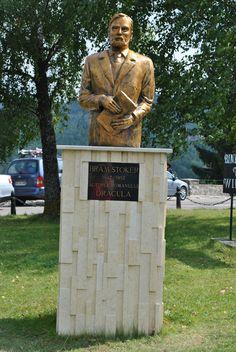Bram Stoker's statue in front of Dracula Castle Hotel in Bistrita