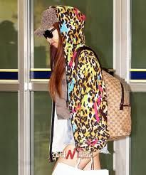 F(X) Leader :: Victoria/ Song Qian.  - Victoria is known to be for her flexible body as long her cuteness. Victoria is known to be her beauty as she walks out of the airport wearing an rainbow jacket as the hoodie is on her head covering hat as she cover her eyes with an shade of glasses.  #f(x) #Victoria