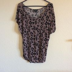 Cheetah print t-shirt Casual cotton cheetah print t-shirt. Cute with leggings. Two small holes by left sleeve(see picture) easy fix/ not obvious, especially when worn with scarf! Tops Tees - Short Sleeve