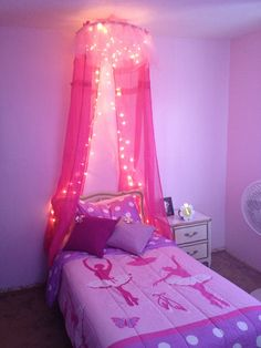 Bed canopy made from a hula hoop tule and dollar store curtains and lights :-) love it so does my little princess !!