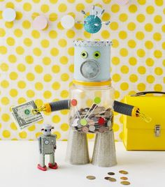 Who says saving money can't be fun for kids? Make this awesome DIY robot bank craft with your little savers this week! Recycled Robot, Recycled Crafts Kids, Fun Crafts, Recycled Art, Creative Crafts, Wood Crafts, Projects For Kids, Diy For Kids, Crafts For Kids