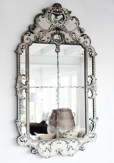 Now THIS is what needs to be in my entry way over my table, but of course I would need to refinish the table, I'm thinking a whitewashed turquoise and add a chandelier dripping with crystals now that would be one Fantastic Entry!