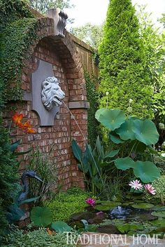 Water splashes from a lions head set into a brick arch into an aquatic garden br… – Garden Projects Brick Arch, Herb Garden Design, Water Garden, Fountain Garden, Garden Fountains Outdoor, Garden Ponds, Koi Ponds, Water Features In The Garden, Garden Projects
