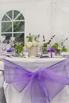 Vintage floral arrangements by the White Horse Flower Company, look stunning with Fuschia's violet organsa chair bows and accessories by www.fuschiadesigns.co.uk.