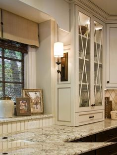Elegant White Kitchen >> http://www.diynetwork.com/kitchen/kitchen-chandeliers-pendants-and-under-cabinet-lighting/pictures/index.html?soc=pinterest#