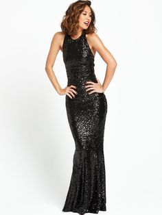 Myleene Klass Black Sequin Embellished Maxi Dress Bringing all the glitz and glam of the seventies to your party wardrobe this season is this stunning embellished maxi dress by Myleene Klass. Floor length with a halter-inspired neckline, it's cut to a flattering, fluid shape with a classy and feminine feel, while the subtle fishtail design won't go unnoticed! Covering you head-to-toe in shimmering black sequins, this dress is a lesson in chic dressing.  Adding a slick of ruby red lipstick…
