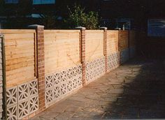 wall and fence with decorative concrete insets underneath the fence Backyard Fences, Backyard Landscaping, Decorative Fence Panels, Decorative Concrete, Breeze Block Wall, Concrete Block Walls, Mid Century Exterior, Timber Fencing, Brick And Wood