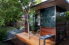 """$31,500.  The Sett Studio office is more like a pre-fab house, with a """"water and ice shield roof membrane"""" and Drywall walls and Monotred flooring.     You can add upgrades like air conditioning and heat, a built-in desk, stainless steel metal shingles and even planter boxes. You can even add a deck.     The company is also working on a solar-powered version."""