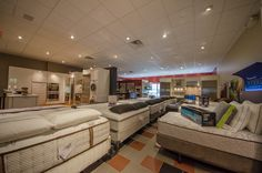 Mattress showroom.  Sealy. Posturepedic. Hybrid. Sterns and Foster.