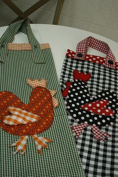 Apron with appliqué of chicken on nest. Nest is pocket or series or straw, basket or eggs!