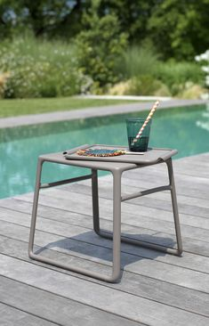 The Pop side table is a nice small table to have next to you at the pool.