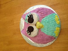 """Owl cake for Sky's 8th bday. Used a 12"""" round for the body, 3"""" round for eyes, & 3"""" round for ears cut to shape. 2 cake mixes (we did a swirl of choc & vanilla.) 2 large batches buttercream frosting. Yum!"""