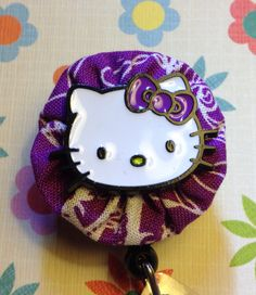 Hello Kitty on purple/white fabric retractable badge reel on Etsy, $12.00