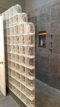 Modern walkin shower, glass tile, jets, recessed shelf, narrow