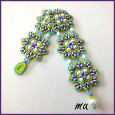 Free downloadable pattern for this bracelet, though, it needs translating. You could follow the pictures pretty well though.