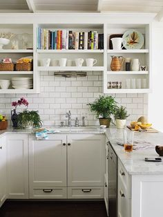 Love the open shelving and particularly the nook for cookbooks!