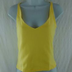 Cross straps tank top. NWOT. Cotton spandex tank top. Front of top is made with a double layer of fabric. Moda International Tops Tank Tops