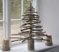 Christmas tree from differing lengths of driftwood.  Add seashell ornaments.