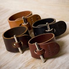 "awesome Leather cuffs with an intersting ""clasp"". I wonder if you could use a ..."
