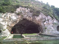 The grotto of Tiberius at Sperlongo , Italy . The scene of infamous gatherings