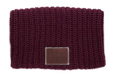 This beanie is knit out of 100% cotton yarn in a burgundy color and features a brown leather patch that is debossed with the Love Your Melon logo. Made in the USA, machine washable, durable. Fifty Per