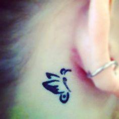 Behind the ear tattoo