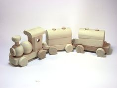 Children's toy - locomotive with carriages a trailer made of wood beech, ready for painting. A great gift for your child.