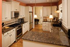 Cream Painted Kitchen Cabinets, Gray Countertops, Travertine Tile Backsplash...i  Would