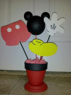 Mickey centerpiece. Used clay pot for this one and fun foam for shapes. Mickey head is hand painted styrofoam balls insert toothpicks and glue to keep ears in place.