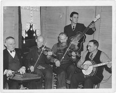 """The Bog Trotters Band, photographed in Galax, Virginia in 1937. Band members include Doc Davis on autoharp, Alex Dunford (fiddle), Crockett Ward (fiddle), Wade Ward (banjo), and Fields Ward (guitar).  1937  The Lomax Collection at the U.S. Library of Congress  unknown """"CBS photographer"""""""