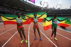 Meseret Defar of Ethiopia celebrates with Tirunesh Dibaba…