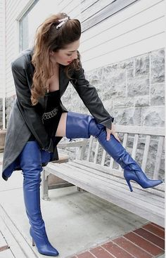 Blue thigh boots and long black leather coat