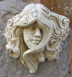 Have a look at this Green Woman Garden Ornament Armscote page from the Green Man Garden Ornaments department at Marble Inspiration