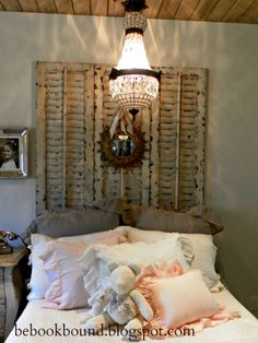 Love the shutters behind the bed instead of a headboard, and the mirror and pendant add a nice touch!!