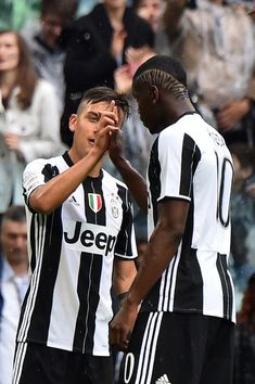 "Juventus' Argentinian striker Paulo Dybala (L) and Juventus' French midfielder Paul Pogba celebrate during the Italian Serie A football match Juventus vs Sampdoria on May 14, 2016 at the ""Juventus Stadium"" in Turin. .Juventus celebrates a record-equalling fifth consecutive Serie A title. / AFP / GIUSEPPE CACACE"