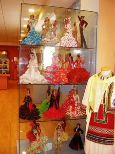 Shelves of regional costumes live in this space for the enjoyment of visitors.