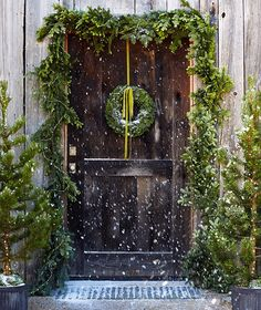 Fresh trees and hand-crafted wreaths for the doorstep. Natural Christmas, Modern Christmas, Christmas Love, Country Christmas, Winter Christmas, Primitive Christmas, Christmas Front Doors, Christmas Porch, Outdoor Christmas