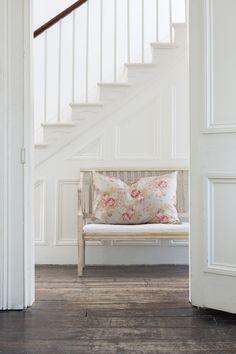 white hallway & stairs