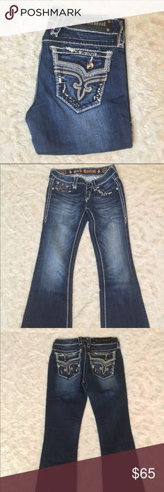 """Rock Revival Bootcut This is a pair of buckle exclusive jeans. Size 25, inseam 28"""", rise 7"""". Slight fraying on bottom legs, but overall in great conditions. 98% cotton 2% elastin. No trades. Rock Revival Jeans Boot Cut"""