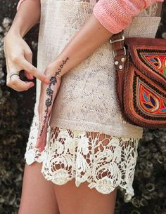floral hand tattoo crochet and a cute leather bag