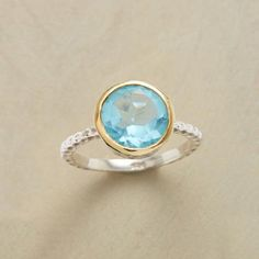 STARRY BLUE RING - Our clear-as-day blue topaz ring reveals not a sun but a star within its depths. Sundance exclusive handcrafted in sterling silver; 14kt vermeil bezel. Whole sizes 5 to 9.