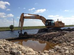 The old Tamiami Trail roadway was broken through today during roadway removal efforts as part of the Tamiami Trail Modifications project in Miami, Fla. The road has served as a longstanding physical barrier, preventing water from flowing in...to Everglades National Park. While there is still much more work to be done on the project, removal of the one-mile section of roadway will bring the project one step closer to completion.
