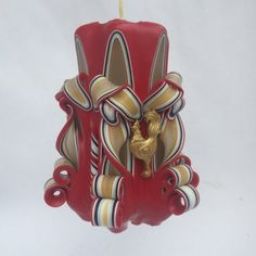 This hand-carved pillar candle is made in gold and red, and features three gold rooster embellishments. It can be customized for any year! Red Candles, Pillar Candles, Rooster Chinese New Year, Restaurant Themes, Custom Candles, Unity Candle, Amazing Decor, Candle Stand, Hand Carved