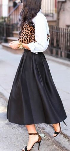 Black midi skirt + white blouse + animal prints