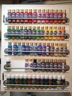 With a few towel bars and dowels, this crafter can see (and admire!) every shade of paint she owns at once in an organized cabinet.