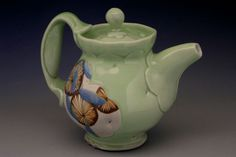 Jennifer Allen ~ All work is wheel-thrown and altered porcelain. Some pieces incorporate hand-built elements. A variety of slip and glaze decoration is applied at both green and bisque stages. Each piece is then gas fired to cone ten in a reduction atmosphere.