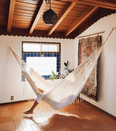 A hammock is the perfect place to recline and relax. Install an indoor hammock for beachy relaxation all year long. For more indoor hammock design ideas, visit domino. Hammock In Bedroom, Indoor Hammock Bed, Diy Hammock, Hammock Ideas, My New Room, My Room, Up House, Wood Beams, Celebrity Houses
