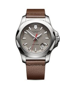 Victorinox Swiss Army opts for understated with a leather-strap timepiece finished in a subdued palette of grays and browns. | Made in Switzerland | Case size: 43mm | Buckle closure | Water resistant